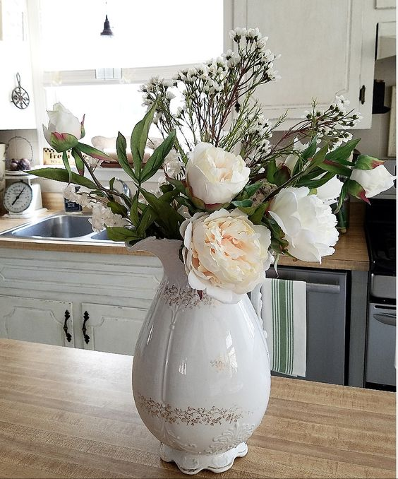 Beautiful spring flower arrangement in an ironstone pitcher. Farmhouse style floral arrangement