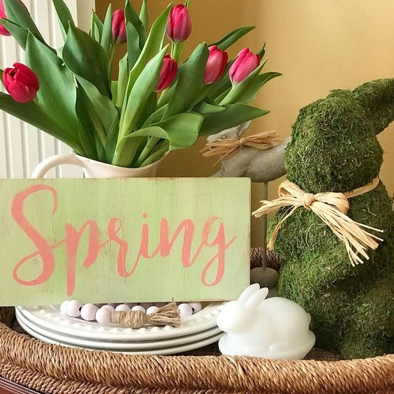 Spring Farmhouse sign vignette with mossy Easter bunny and pink tulips