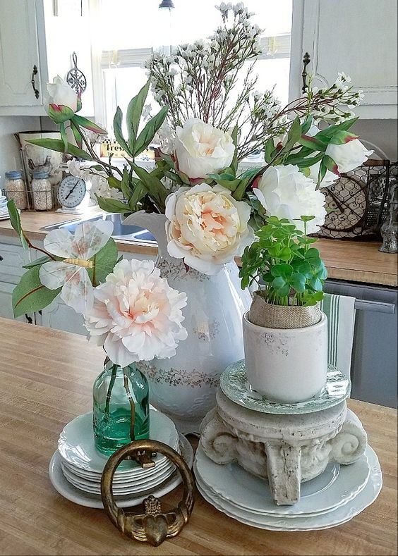 Stunning spring vignette using faux flowers and brocante farmhouse treasures