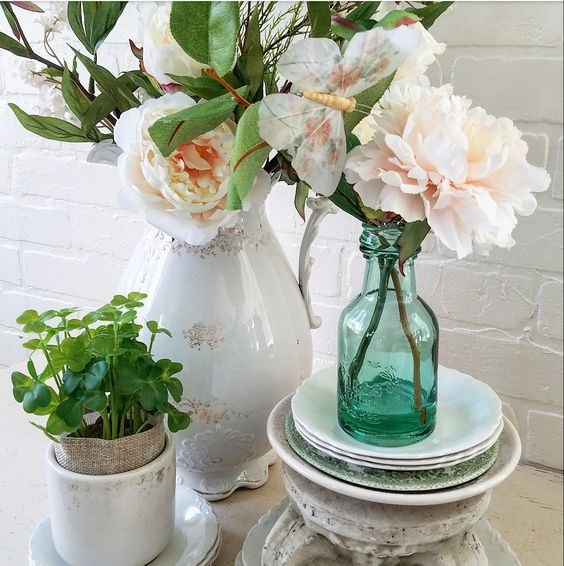 Create beautiful vignettes using faux floral arrangments.
