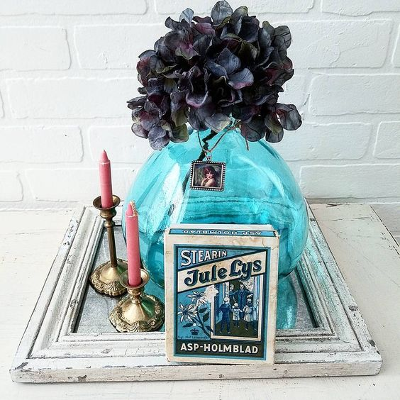 Gorgeous vintage brocante vignette with a beautiful blue demijohn