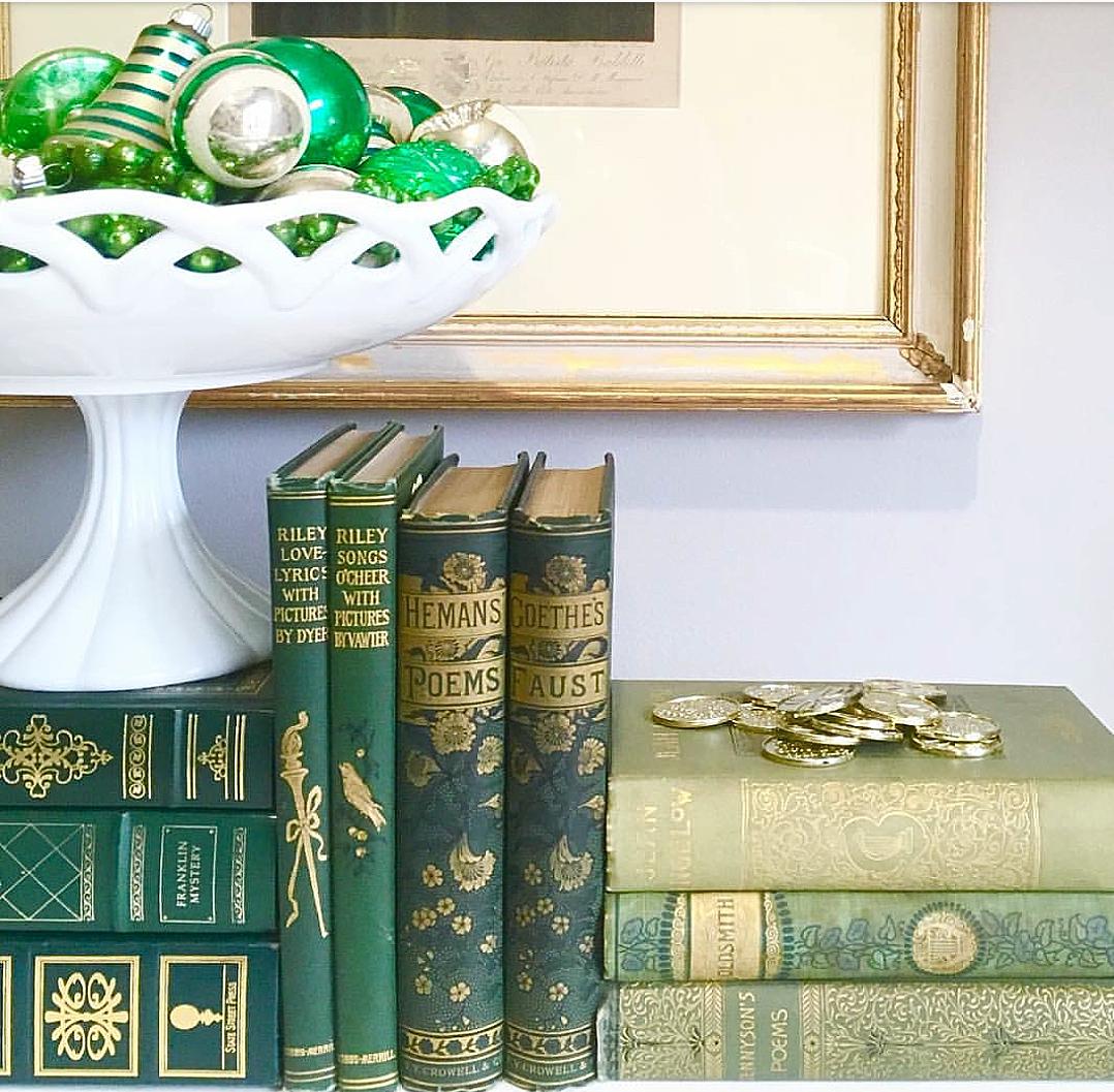 gorgeous green vignette vintage green shiny brite ornaments antique books green decor milk glass