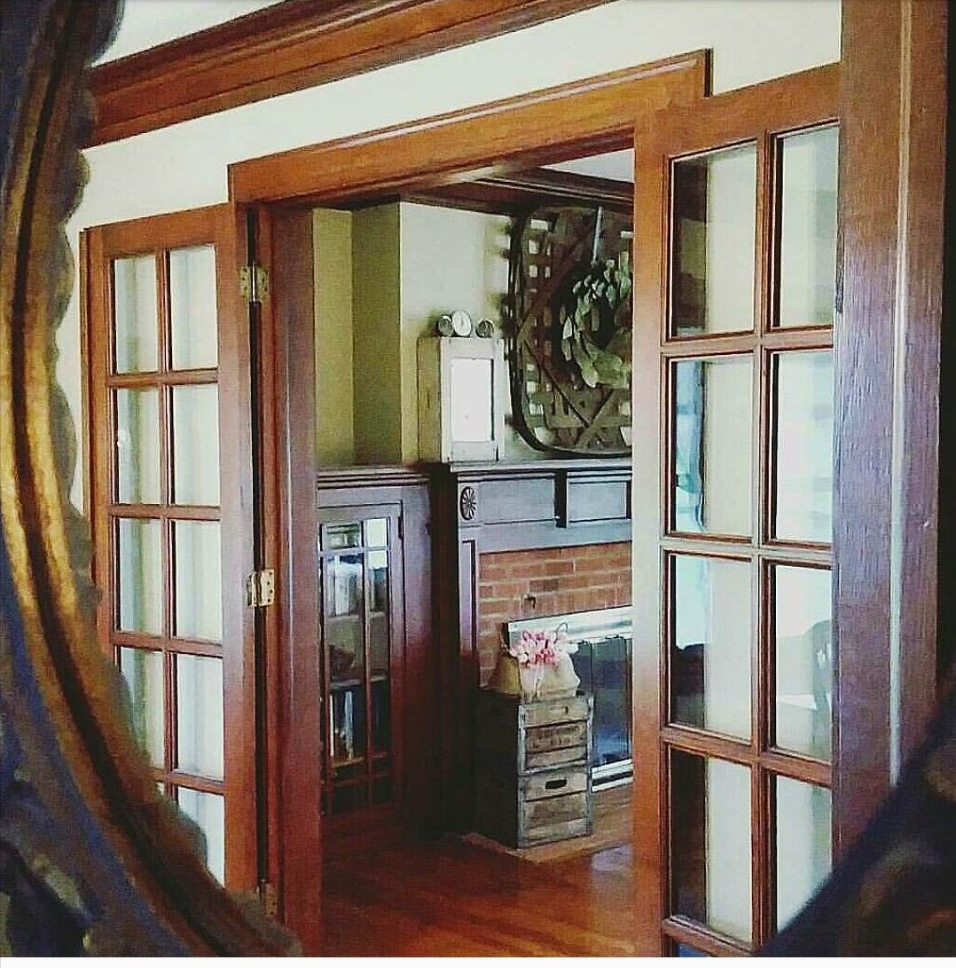 redbrickfarmhouse1919 original woodwork unpainted woodwork french doors stained trim