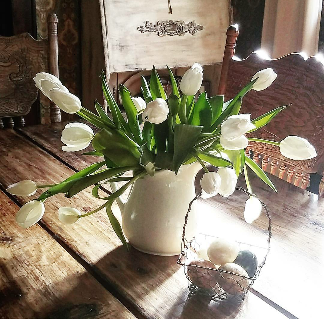 Farmhouse tablescape pretty tulips in ironstone pitcher on a farm table