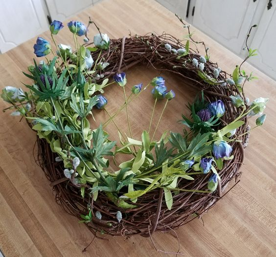 How to make a beautiful spring wreath grapevine wreath with blue roses, moss , thistle and pussy willow spring wreath