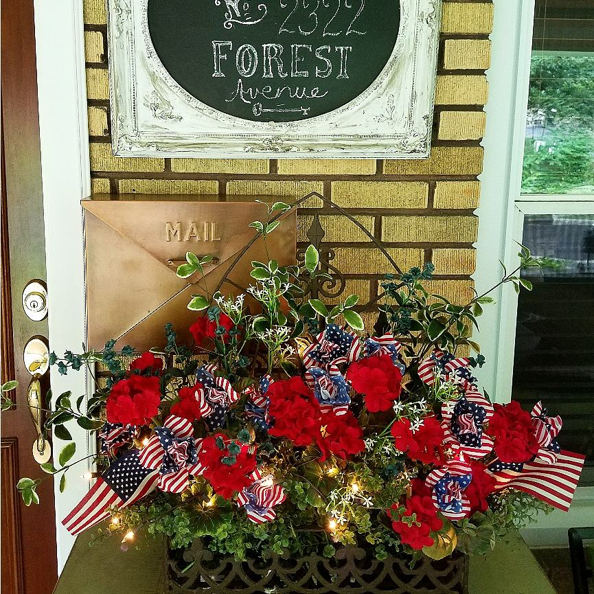 Beautiful Patriotic Floral arrangement with American Flags