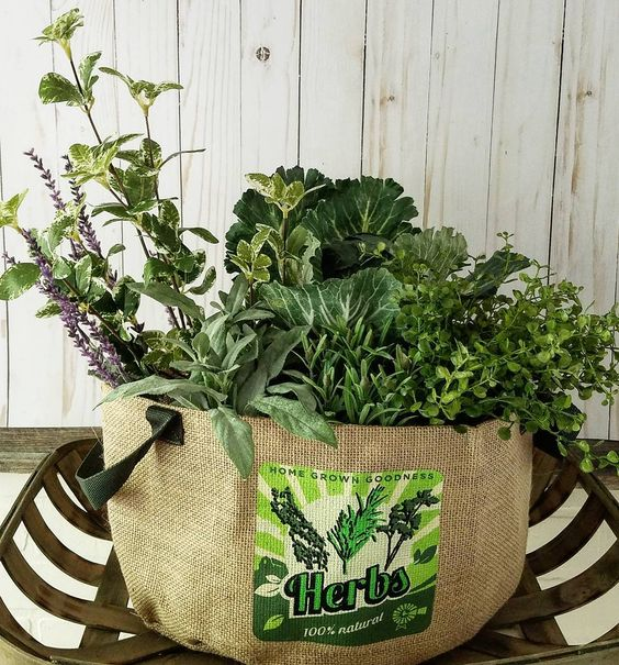 Beautiful faux herbs and vegetables arrangement in a herb tote and tobacco basket