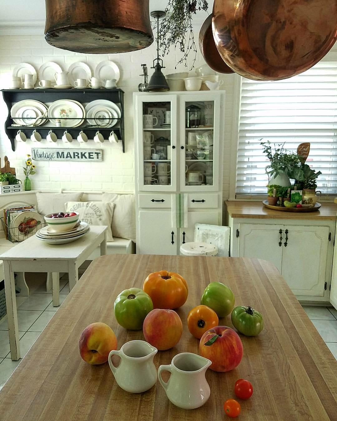Gorgeous Farmhouse Kitchen Banquette seating ironstone plate shelf white kitchen