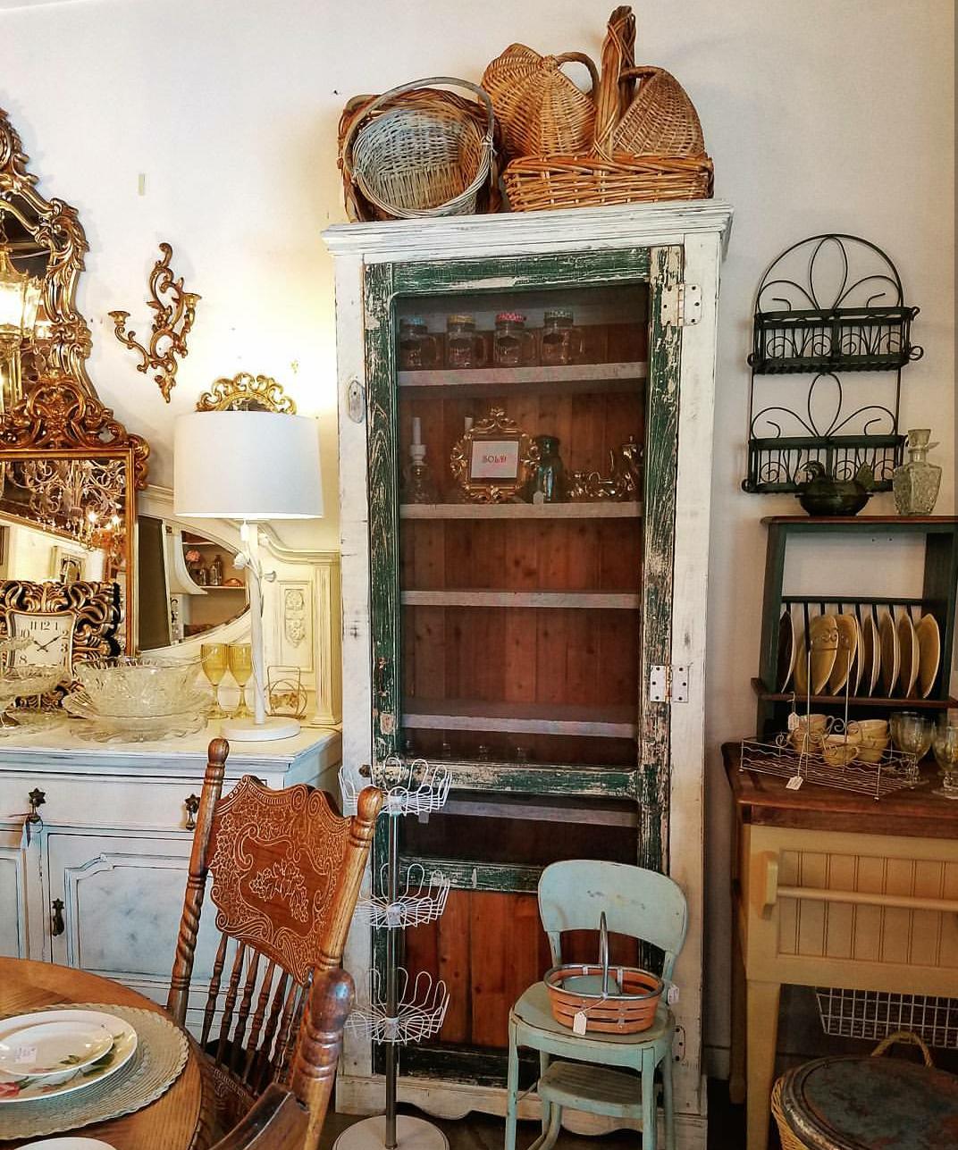 antiques store vintage store pressed back chair vintage basket vintage dishes