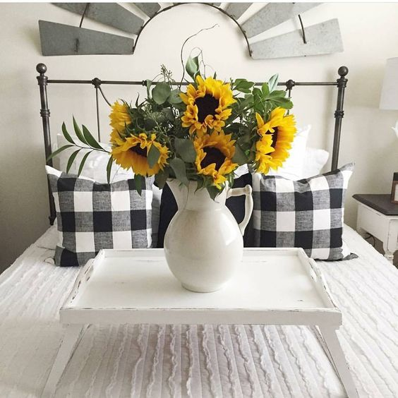 beautiful farmhouse industral bedroom wrought iron bed buffalo check pillows tray on bed with ironstone and sunflowers fall decorating ideas.