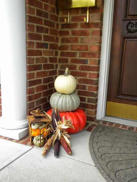 Gorgeous fall porch decor stacked pumpkins