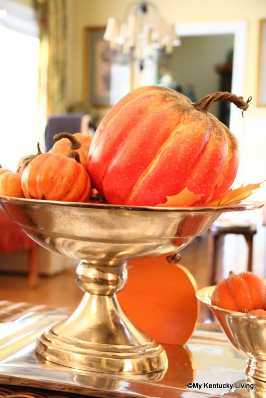 Gorgeous silver urn filled with pumpkins and leaves simple fall and elegant Halloween decor