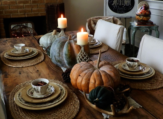 Gorgeous late fall tablescape on an antique farm table