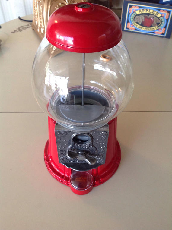 Make a cute Christmas waterless snow globe with a vintage gumball machine