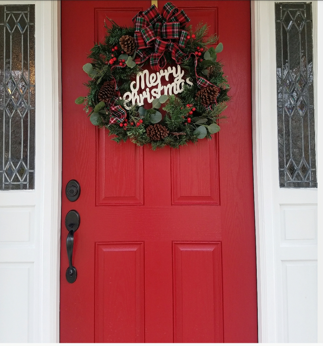 Christmas Wreath on red front door red door