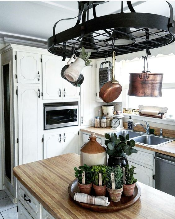 Gorgeous Galley Style Kitchen white kitchen distressed cabinets copper pots pot rack kitchen styling ideas
