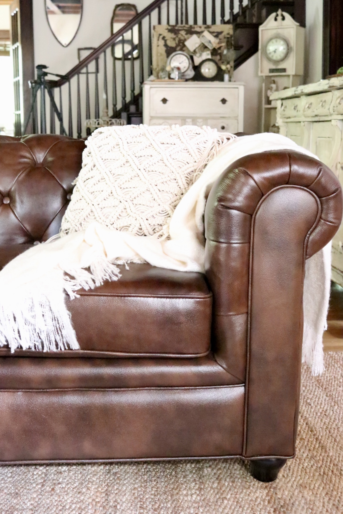 Beautiful Leather Chesterfield sofa macrame boho throw pillow neutral decor jute area rug from Soft Surroundings