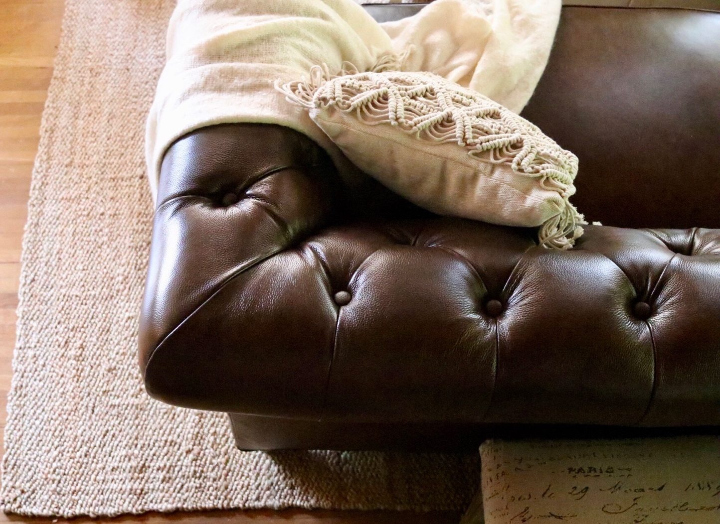Brown leather chesterfield sofa boho pillow macrame pillow throw jute area rug from Soft Surroundings
