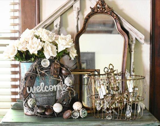 Beautiful shabby chic French vintage entry way vignette with handmade vintage door knob wreath