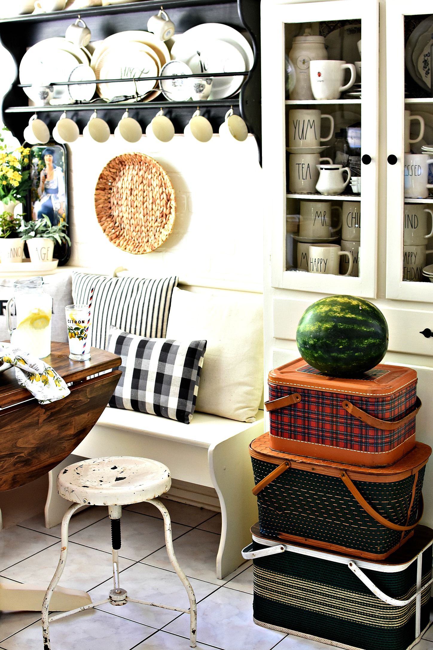 summer decorating ideas stack of vintage picnic baskets in farmhouse kitchen Rae Dunn display ideas summer home tour