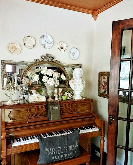plate gallery wall above piano shabby chic vintage decor