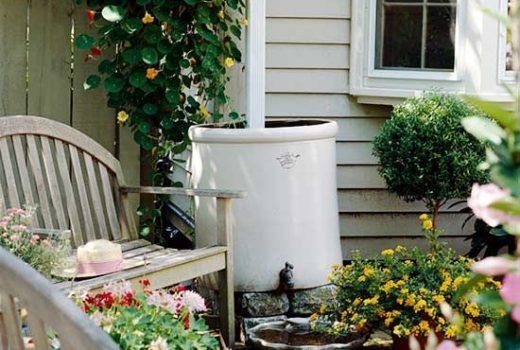 old crock repurposed as rain barrel