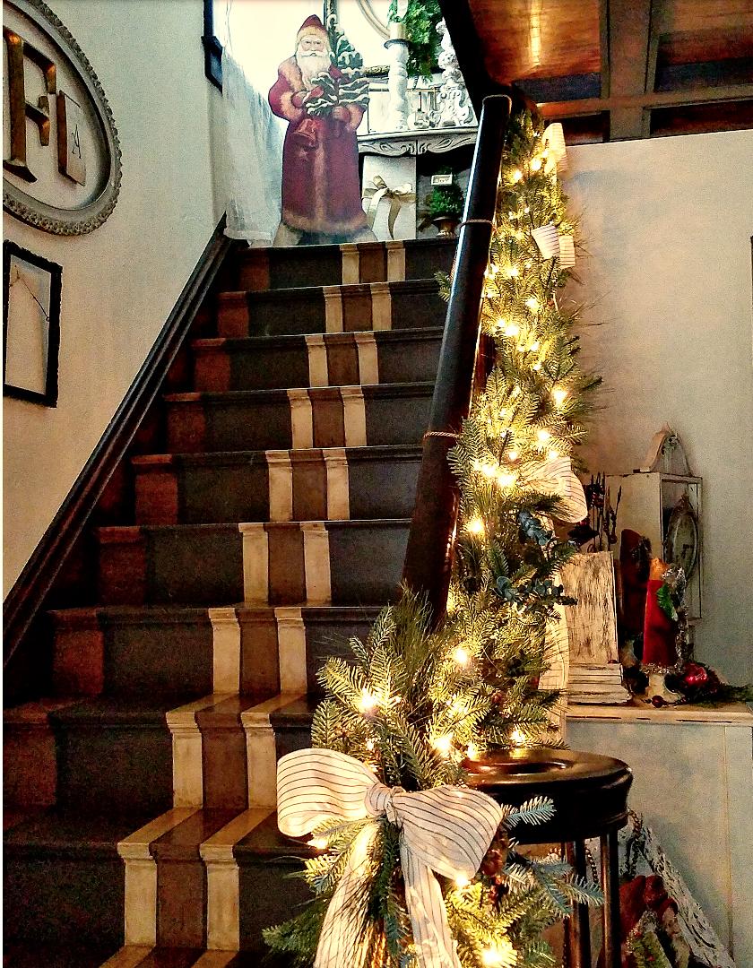 Pretty Christmas Staircase banister garland Balsam Hill