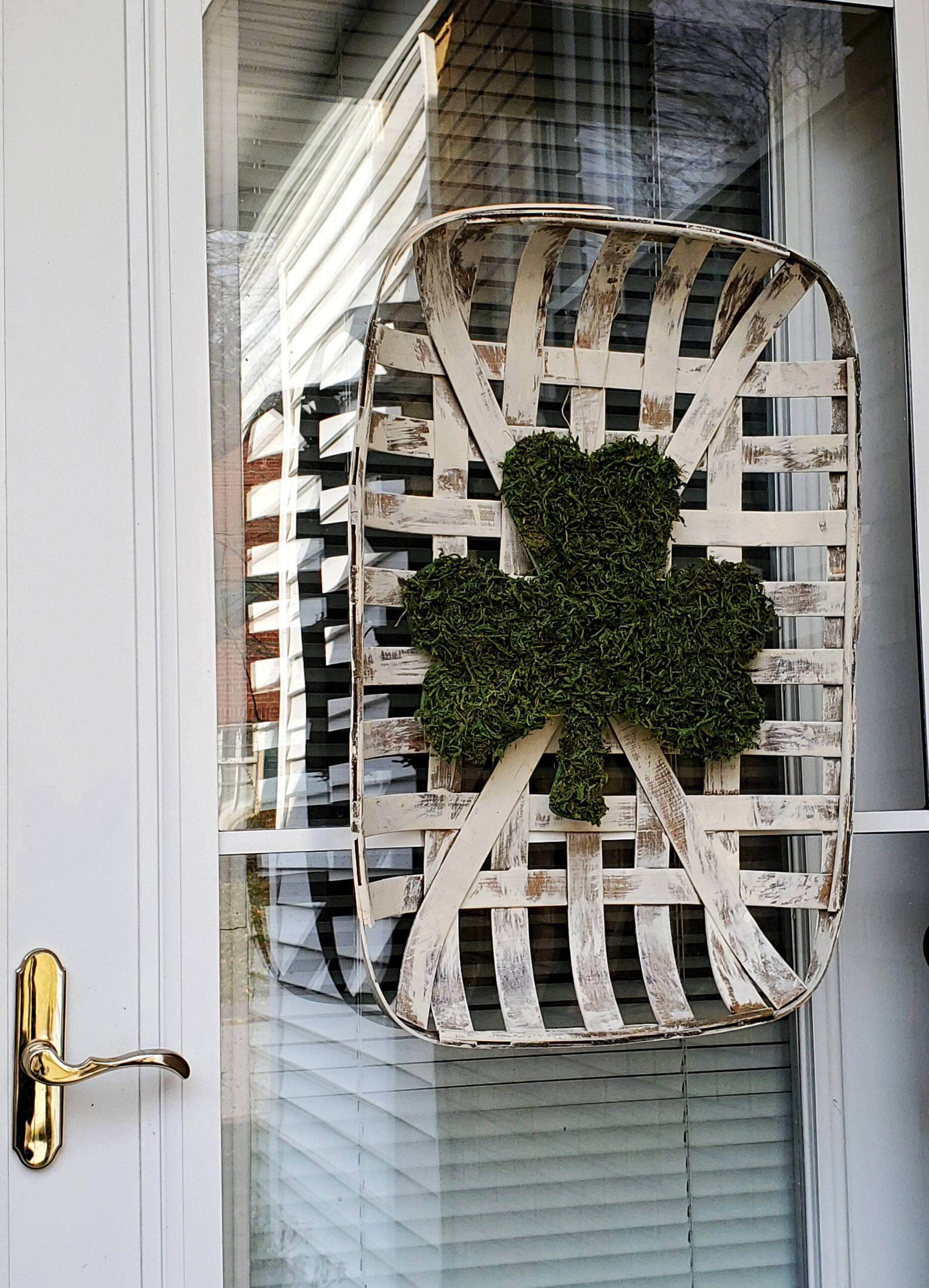 Diy Moss covered shamrock on a tobacco basket door decor