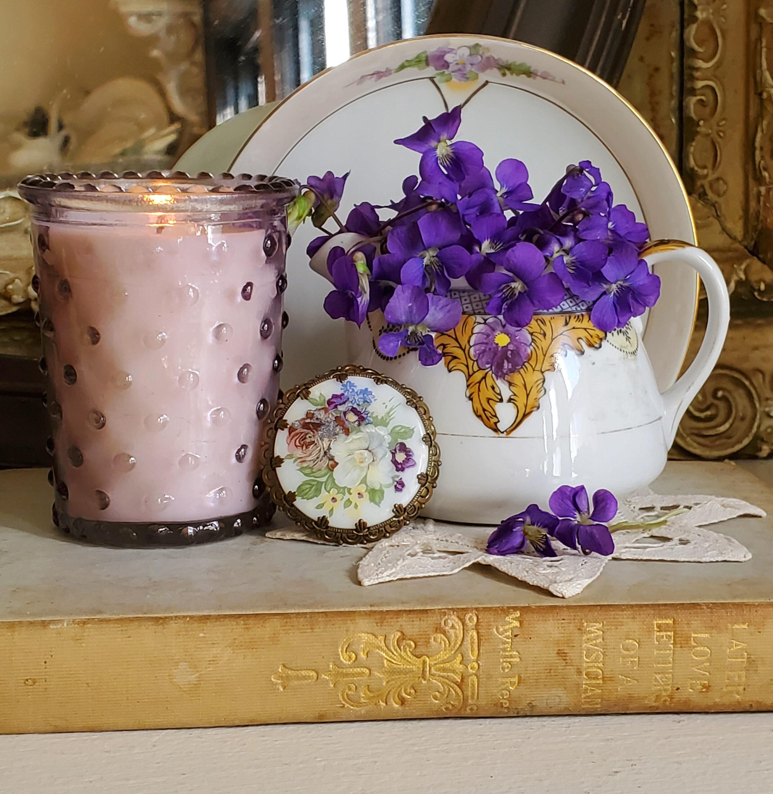 vintage vignette with sweet violets purple vignette with vintage dishes