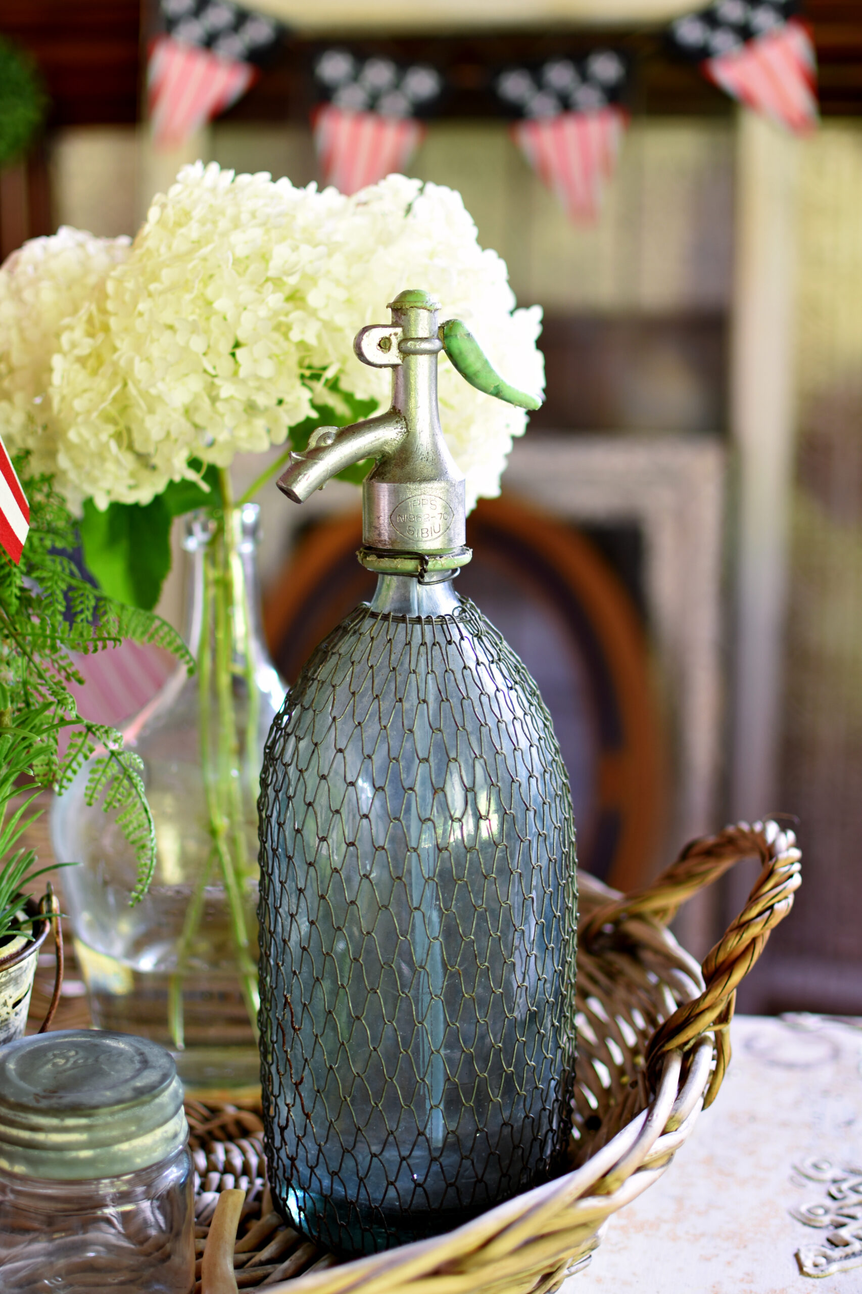 blue French Seltzer bottle with mesh