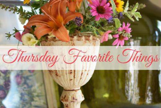 cut flower arrangment in a pretty urn