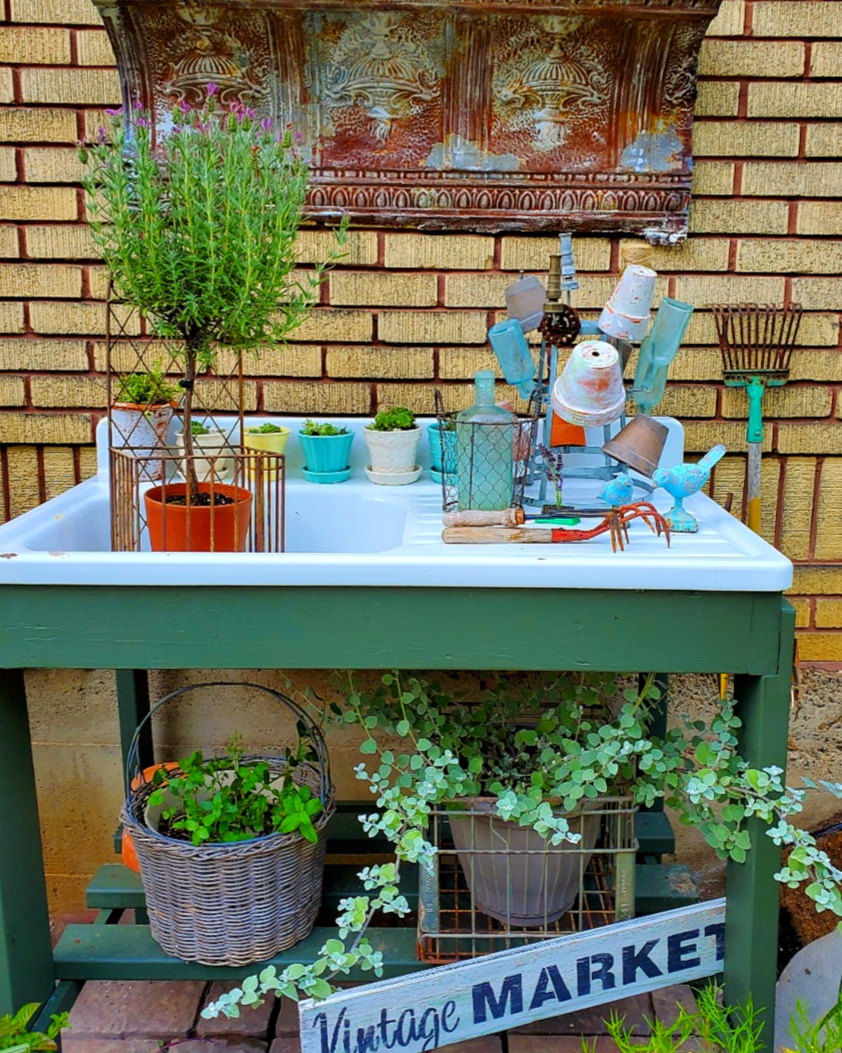 garden potting benchn with rosemary topiary french garden pots bottle drying rack with pots and vintage bottles