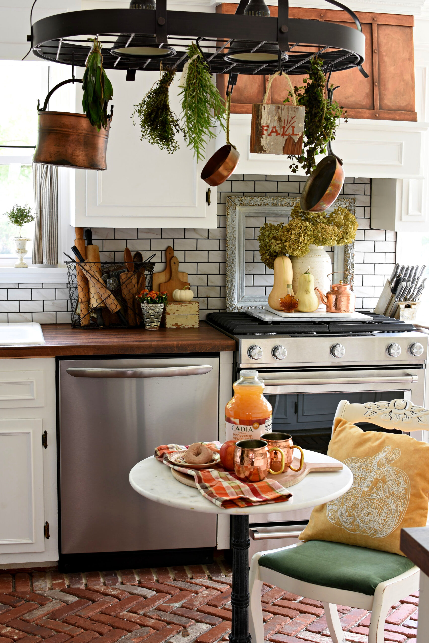 french kitchen pot rack with drying herbs and copper pots fall kitchen makeover fall kitchen ideas