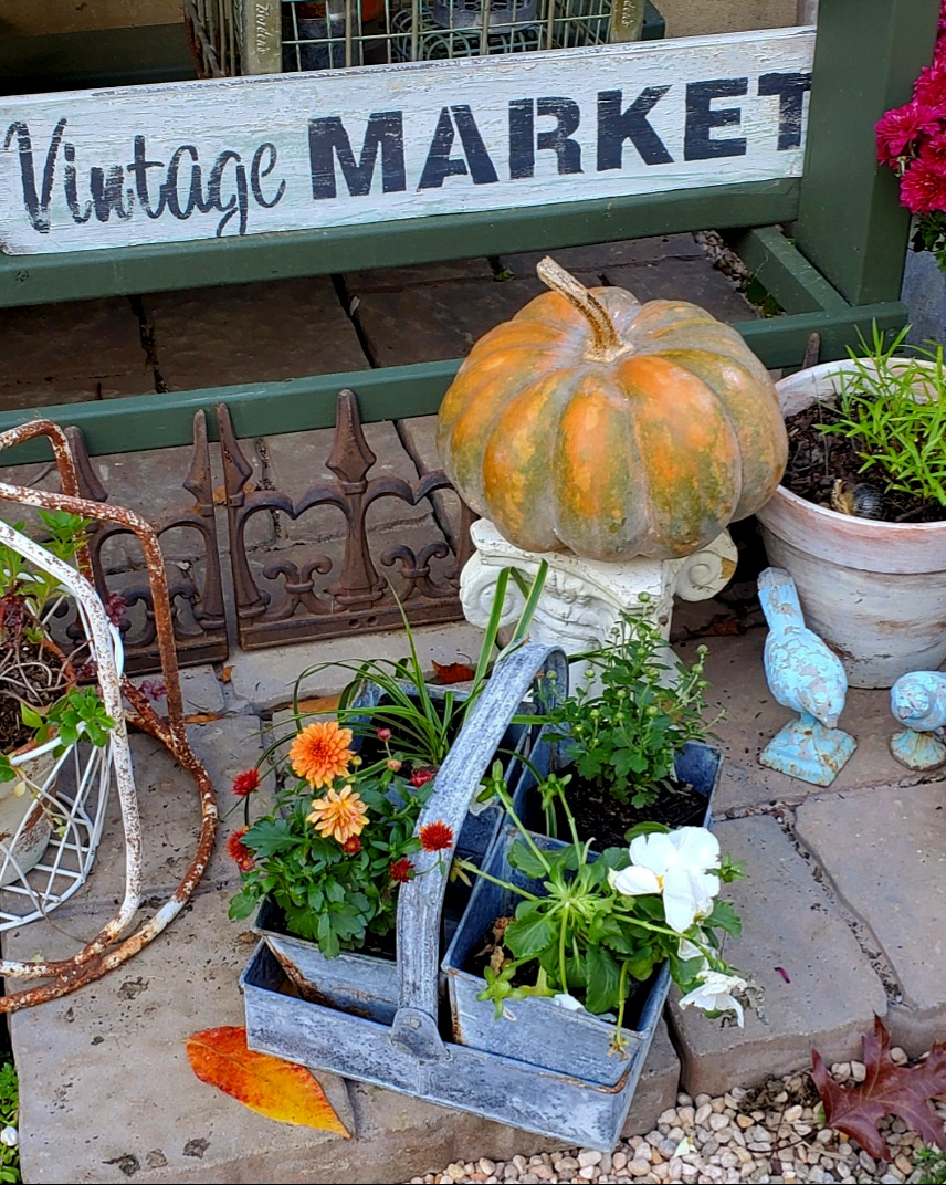 vintage fall garden ideas galvanized flower tray with mums and pansies musquee de provence pumpkin on chippy column