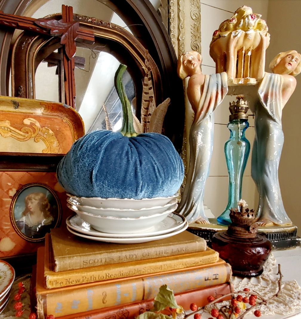 Unique vintage fall vignette with blue velvet pumpkin and thrifted finds