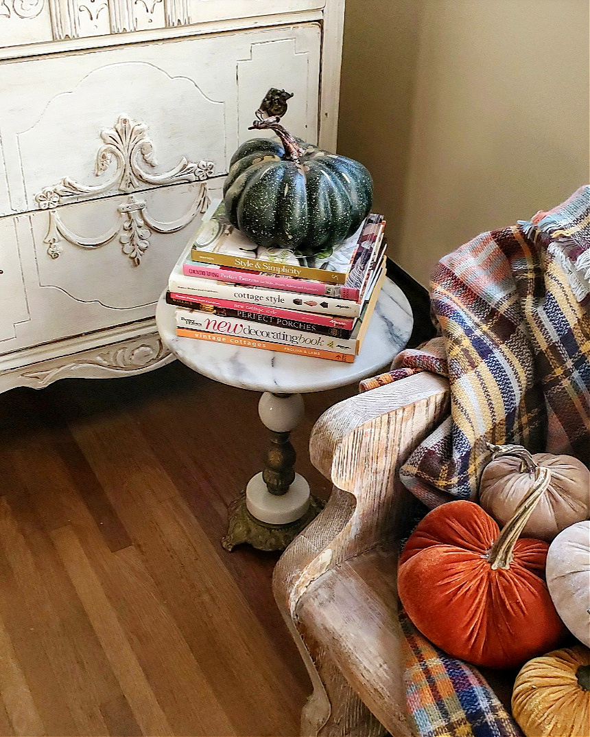 unique vintage fall marble table with a stack of decorating books