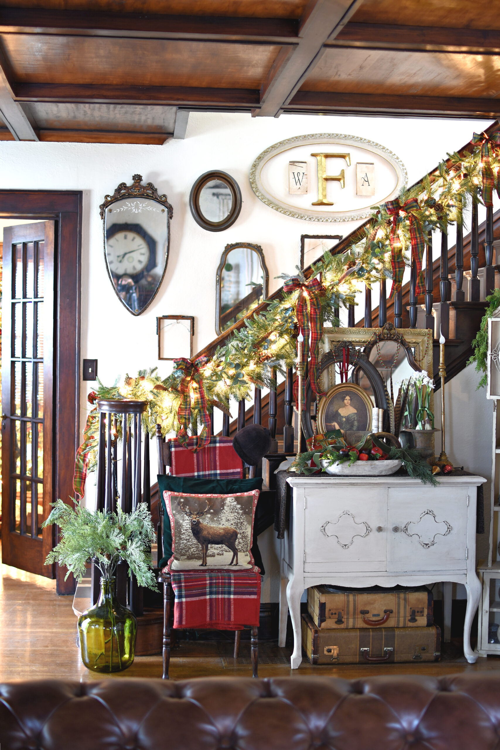 Cozy Christmas staircase with traditional Christmas plaids and antiques. Unique English Country Christmas decorating ideas. Victorian Christmas decorating