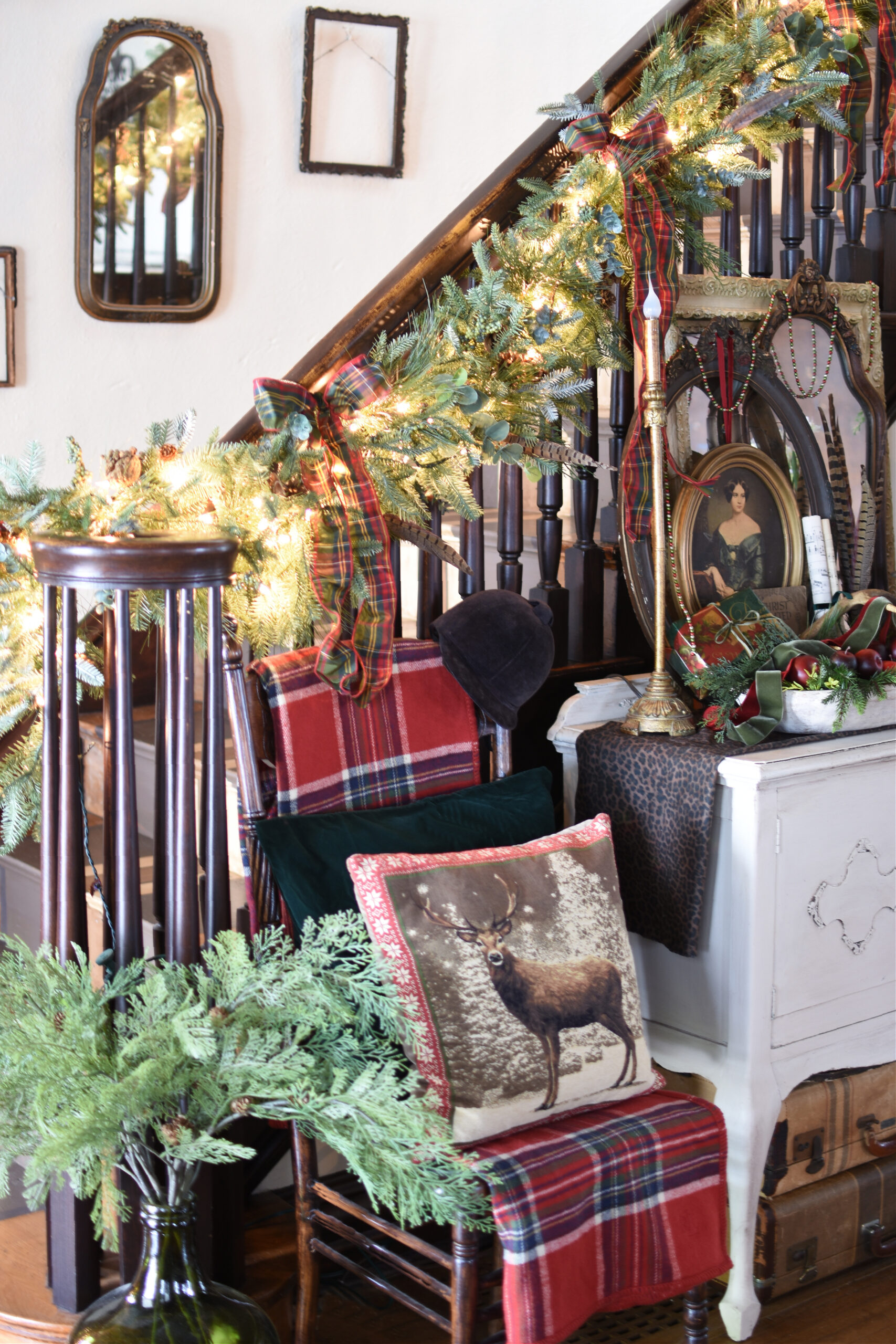 Traditional Christmas Decorating ideas Christmas Staircase garland with plaid bows. Cozy Christmas pillows. Using vintage finds and antique in Christmas decor