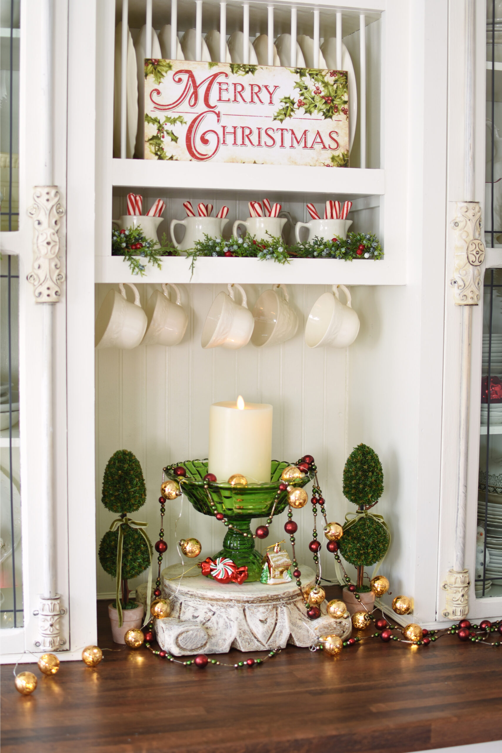 Beautiful Christmas kitchen with plate rack and hanging teacup