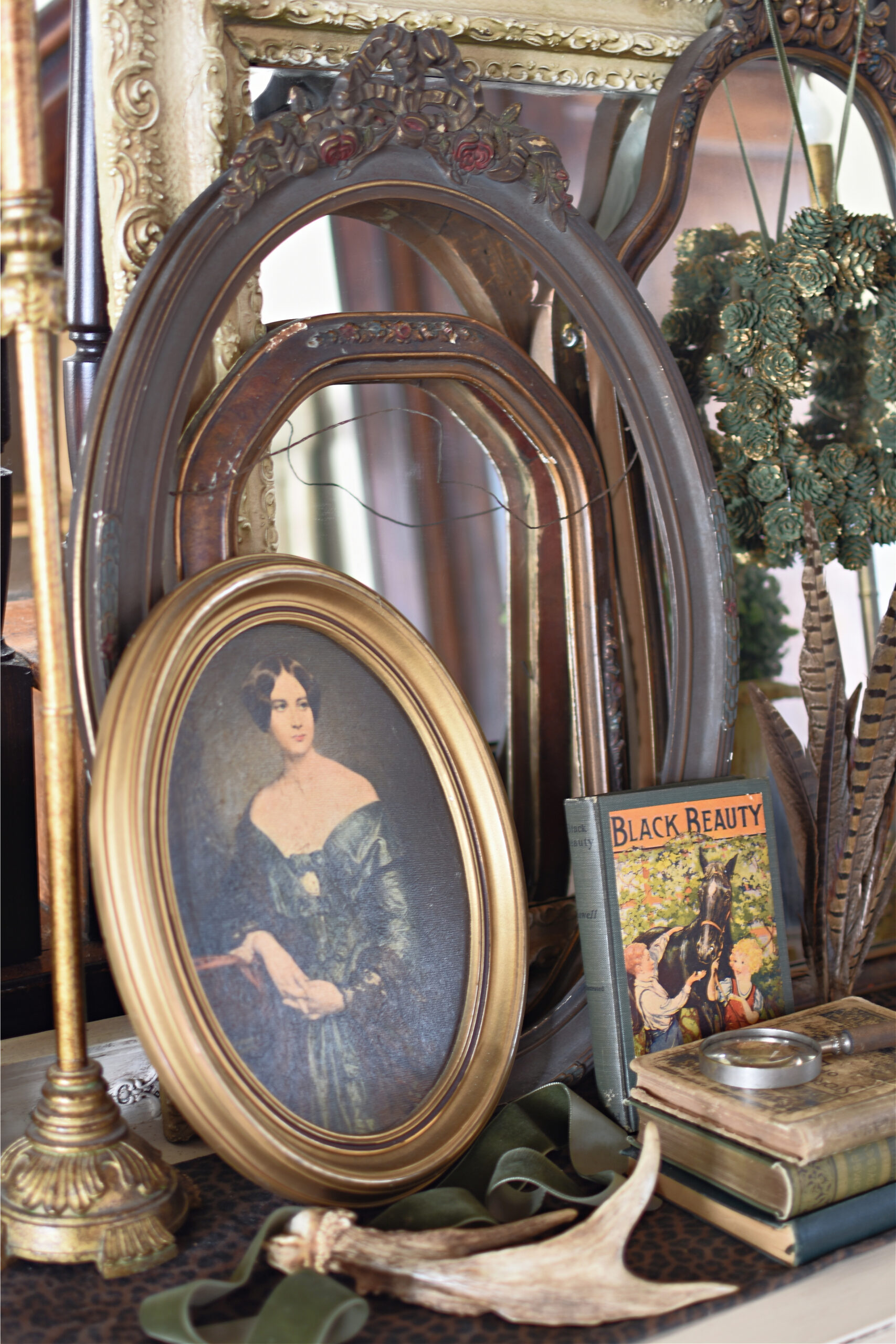 Viintage entryway vignette with vintage books Southern style cottage style