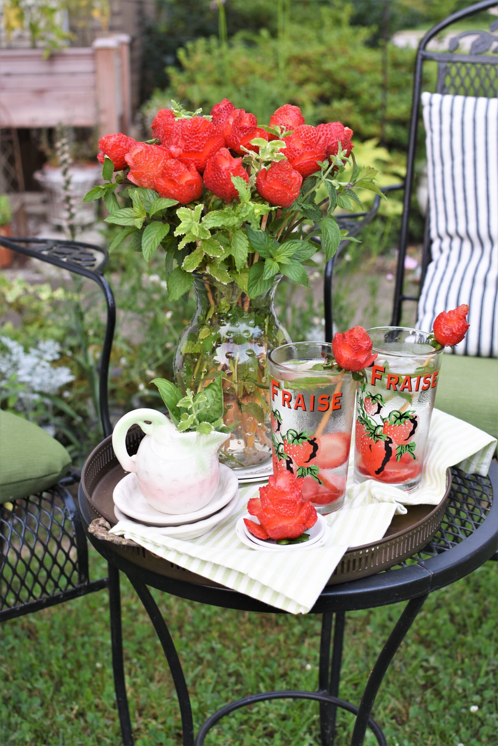 Elegant summer picnic wih strawberry roses bouquet strawberry mint fruit infused water